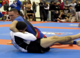 Devin Genchi tapping out Black Belt Joao Moncaio in the Finals - at the time Devin was only a blue belt.